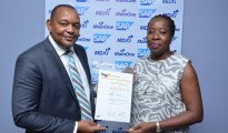 Managing Director of SAP West Africa, Kudzai Danha, presenting the SAP certification for Infrastructure Operations Services to Chief Executive Officer of MainOne, Funke Opeke, during a ceremony held at SAP's Head Office in Nigeria