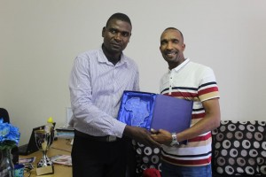 CAJ News Africa CEO Savious-Parker Kwinika (left) receives the award on behalf of the news agency from Miss Africa Executive Director, Mr Neo Mashishi of ProAct Communications. Photo by Gift Ndolwane, CAJ News