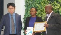 IT Graduate learner Khanyisile Magubane flanked From L-R -Maswikaneng Phatle Solly Acting HOD Department of information Technology  & Huawei Representative Services VP of Huawei Enterprise Business Group for Southern Africa region IMAGE -GIFT NDOLWANE