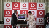 Vuyani Jarana, Chief Officer at Vodacom Business (L) and Minister of Basic Education, Angie Motshekga unveil the 'Virtual Teacher' platform at Vodaworld in Johannebsurg.jpg
