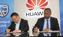(L-R) Likun Zhao, GM Huawei Consumer Business Group SA & Luvuyo Masinda, Head of Client Coverage and Investment Banking (CIB) at Standard Bank during sign in ceremony .IMAGE : GIFT NDOLWANE