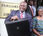 Zimbabwe's finance minister Patrick Chinamasa and his wife Monica before the 2018 budget presentation