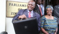 Zimbabwe's finance minister Patrick Chinamasa and his wife Monica before the 2018 budget presentation