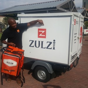 Vutlharhi Valoyi showcasing his technology offering, Zulzi App that has transformed how customers and households in Gauteng province access their groceries from door-to-door