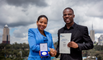 Africa Prize for Engineering Innovation 2018 runner-up winner Collins Saguru is congratulated by Rebecca Enonchong