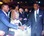 Businessman Frank Buyanga greets Zimbabwe deputy president Kembo Mohadi