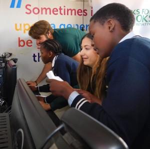 Springbok Lood De Jager and Women's Sevens Rugby player Chané Stadler learning to code with girls from the Emdeni Secondary School in Soweto