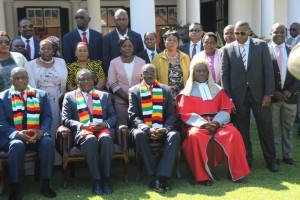 Frank Buyanga, standing next to Chief Justice Luke Malaba at Zimbabwe State House at the swearing in of Zimbabwe Vice Presidents Constantino Chiwenga and Kembo Mohadi