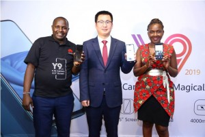 Huawei East and Central Africa Head of Mobile, Steve Li (C), Marketing and Communication Manager, Nakhulo Khaimia (R) and Training Manager, Derrick Alenga, display the new Huawei Y9 during its launch at a Nairobi Hotel
