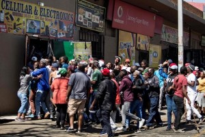 South Africans on the looting spree of foreign owned shops in Johannesburg