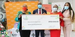 Avon Justine Managing Director for Turkey, Middle East and Africa, Mafahle Mareletse (in suits) hands-over R150, 000 cheque to the Nelson Mandela Children's Hospital executives